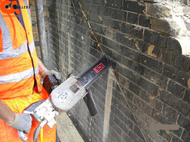 Chainsaw Cutting into Brick Wall - CA Drillers