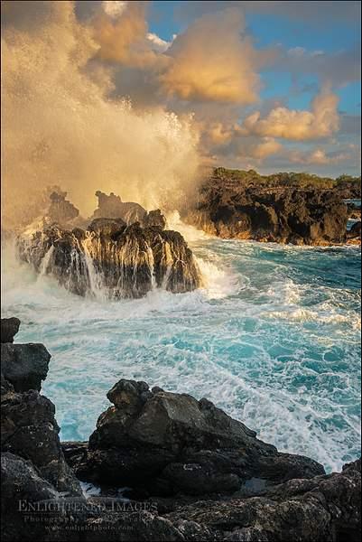 Waves crashing against coastal lava rocks at sunset at The End of the World