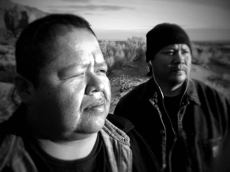 Navajos Enjoy Dawn at Monument Valley