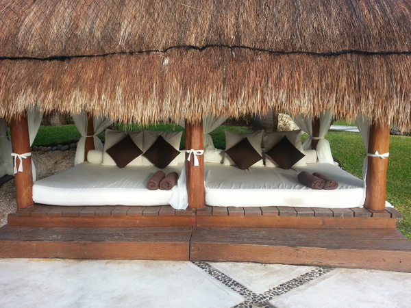 comfortable beds poolside by Aannabandana