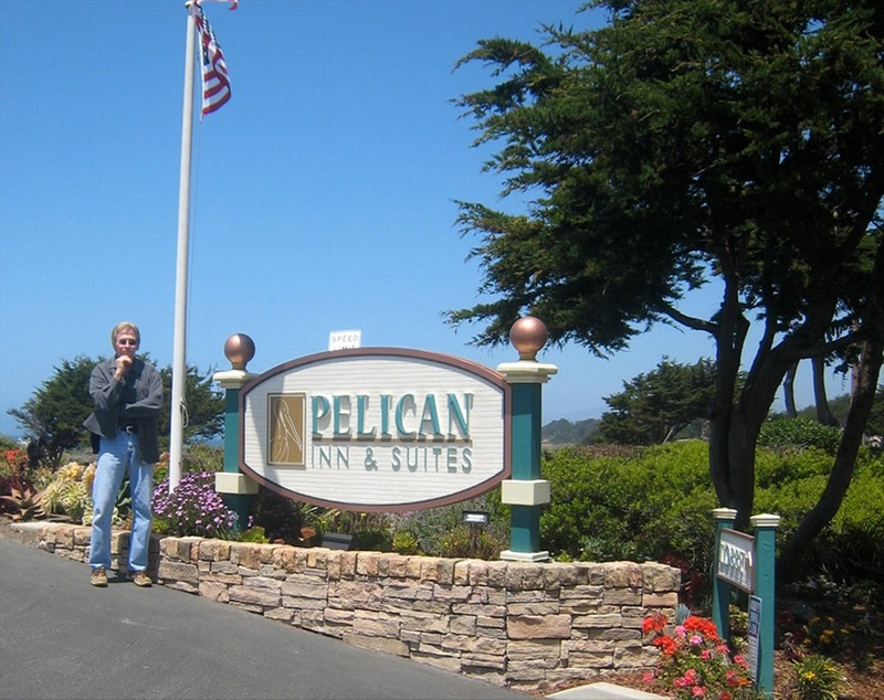 Mark by entrance to Pelican inn in Cambria