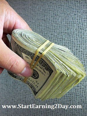 cash_wad-of-money-in-hand by Ric  Lopez