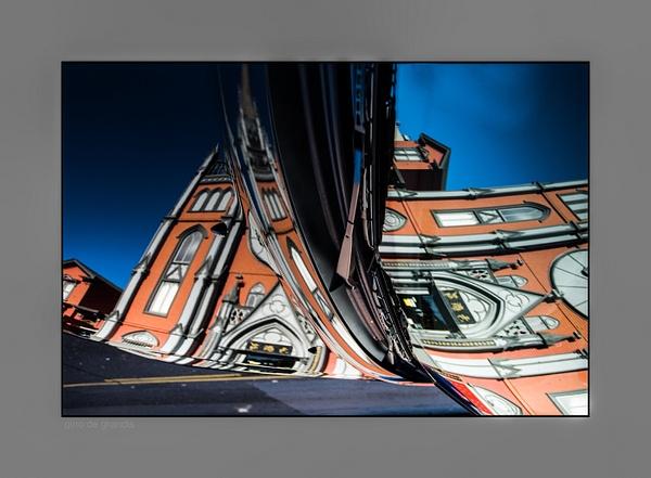 Car- Building Reflection by Gino De  Grandis