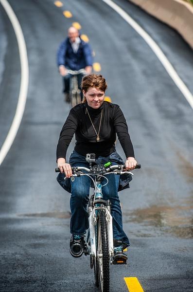 Biking down the hill by Gino De  Grandis