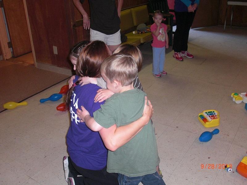 Cue Camp hug