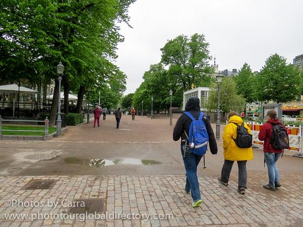 F Suomenlinna 53 ML s M walking through park to train by Carra Riley