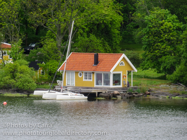 S boat house at entry to Stockholm by Carra Riley