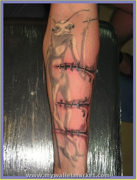 ripped-skin-stitched-cut-3d-arm-tattoo by catherinebrightman