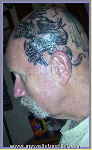 an-old-guy-with-gargoyle-tattoo-on-head by catherinebrightman
