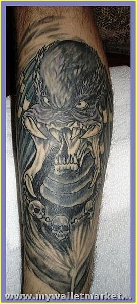crawling-alien-tattoo-design-on-leg by catherinebrightman