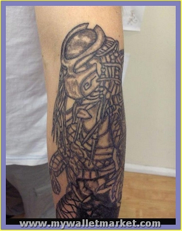 grey-ink-alien-tattoo-on-left-arm