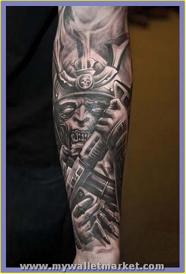 grey-ink-alien-tattoo-on-sleeve