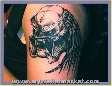 grey-ink-predator-head-tattoo-on-left-shoulder by catherinebrightman
