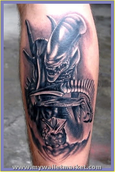 classic-grey-ink-alien-tattoo-on-back-leg by catherinebrightman