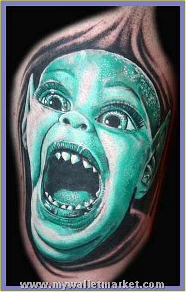 crawling-alien-kid-face-tattoo