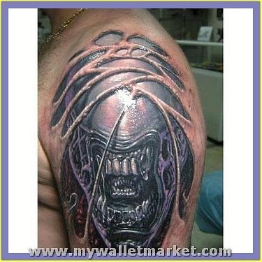 monster-alien-head-tattoo-on-left-shoulder by catherinebrightman