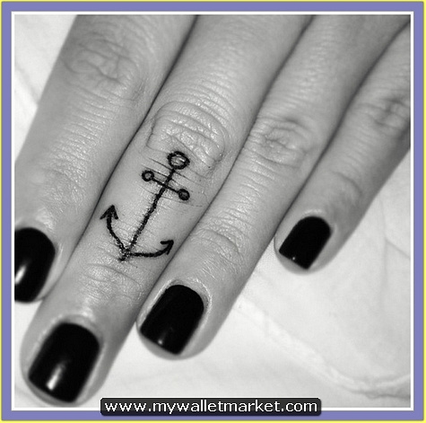 black-anchor-tattoo-on-middle-finger by catherinebrightman